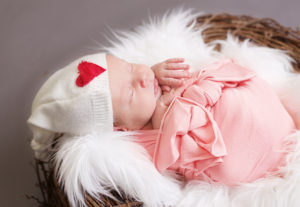 Baby girl with a Valentines Day Hat, Maine newborn Photographer